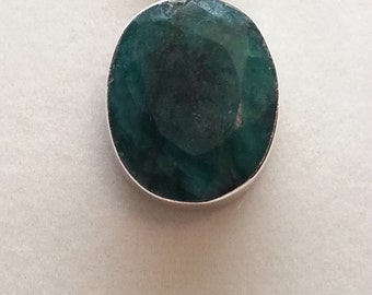Large faceted emerald and sterling silver pendant and chain.