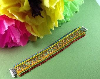 Fiesta Bracelet - fun hand woven peyote bracelet in bright fiesta colors reminiscent of the parties of San Antonio Texas