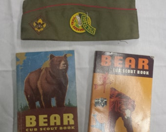 Boy Scout cap and Cub Scout handbooks