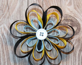 Loopy Ribbon Flower Bow with black, yellow, and light blue ribbon and a white button center on an alligator clip