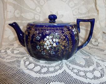 Blue Teapot with Floral Design