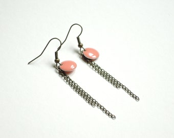 Chains and coral sequin earrings.