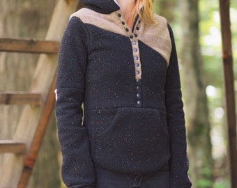 BLACK CONFETTI hoodie : hooded pullover sweatshirt in black with sweater detail and oversized kangaroo pocket. Thumbholes and elbow patches.