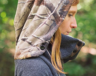 CAMOUFLAGE EXPLORER hoodie: camo and charcoal fleece pullover with built in kangaroo pocket, deep hood and oversized button front cowl.