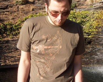 Blossoms from Bullets Men's Tshirt - Gun Flowers Peace Shirt in Army Green