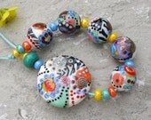 Handmade lampwork round beads and lentil |   Carnival  |    set and focal  |     artisan glass     |     made by Silke Buechler