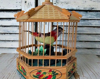 ViNTaGe CHiRPiNG BiRD in CaGe