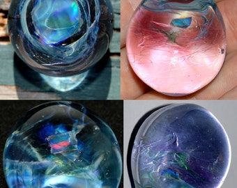 Encased Raw Black Opal Egg suspended in a swirl of Psychedelic Purple Blue Moon and Green Stardust - Handblown Glass Egg