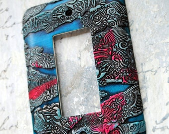 Blue and Pink Abstract, polymer clay over metal switch plate cover, pink, teal blue, gray, black, silver