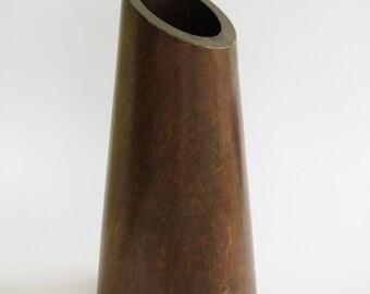 A vintage wooden vase