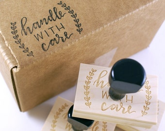 Hand lettered HANDLE WITH CARE Wood Stamp  - calligraphy lettering with laurel wreath - stationery rubber stamp, shop supply