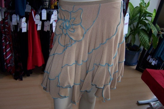 Light brown color skirt with rose decoration and ruffled edging throughout (v11)