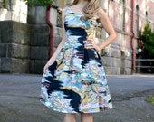 Dress with a pleated skirt in an Asian inspired print, sizes US 0 to 16