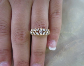 14k Yellow gold marquise diamond ring.