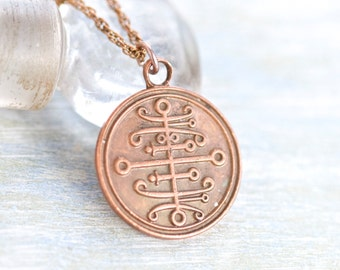 Tribal Twirls Necklace - Copper Medallion Pendant on Chain - Alien Writing