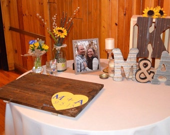 Pallet wood guest book sign with heart. Rustic alternative wedding.