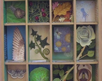 Wooden art installation. Printer tray with individual Nature themed sections. Assemblage of paper sculptures, found objects & original art