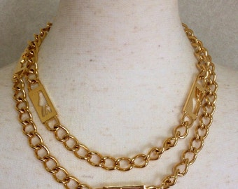 MINT. Vintage Salvatore Ferragamo chain belt with golden shoe charme. Can be worn as a necklace.