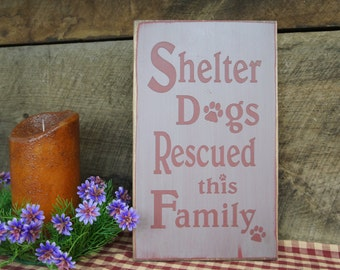 Shelter Dogs Rescued this Family Rustic Sign Dog lovers Unique creation with pawprints in the lettering Great gift for animal loving friends