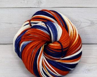 Supernova - Hand Dyed Superwash Merino Wool Worsted Aran Yarn - Colorway: Broncos
