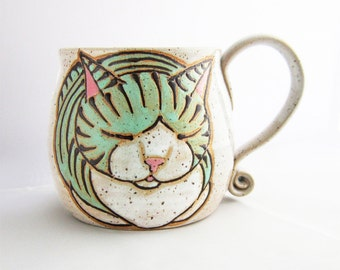 Cat Mug, pottery mug, great Christmas Day gift, cat loaf mug, cat art , holds approx 13 oz and is dishwasher and microwave safe.
