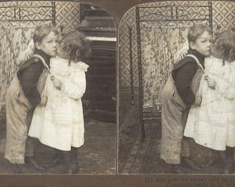 American Stereoscopic Company  - She Gets The Penny and He Gets the Kiss - Stereoview Card