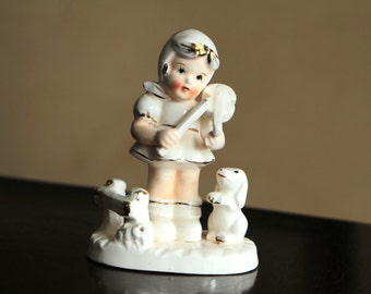 Vintage ceramic figurine - girl with violin and a dog / white with golden trim