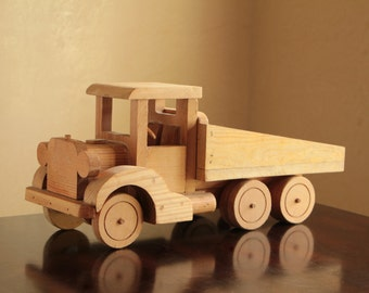 Large wood toy dump truck with rotating wheels / solid pine construction