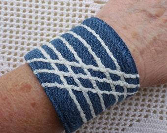 Denim Bracelet Cuff, mother of pearl button, white two tone yarn, dark wash jeans, upcyled vintage denim jewelry, fiber art cuff in 2 sizes