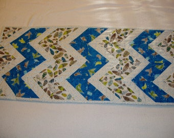 Turquoise blue table runner with birds and feathers hand quilted