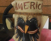 Crow holding an American Banner handpainted on an antique coffee pot, Black Crow, Primitive deor, America with Stars and stripes, Americana