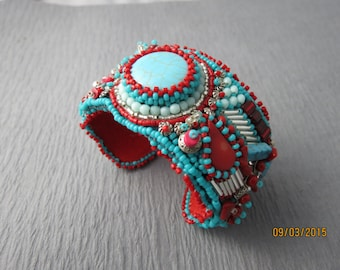 Bead embroidered cuff, turquoise, red and silver