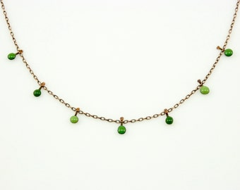 Handmade enameled necklace; 3 shades of tiny green droplets on a copper chain.