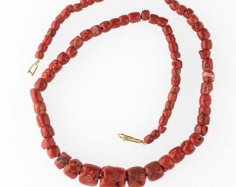Necklace of antique Mediterranean red coral trade beads.(nlja876cs)