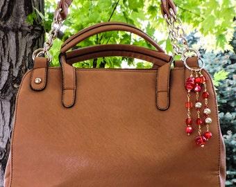 Swril red purse charm