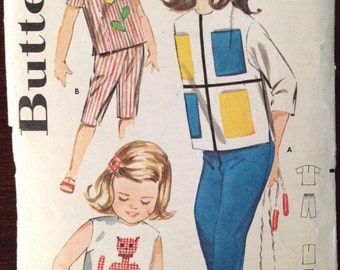 Butterick 2301 – Little Girls Overblouse with Contrast Patch Pockets Cat or Flower Appliqué and Pants, Capri or Shorts – Size  5 Chest 23.5
