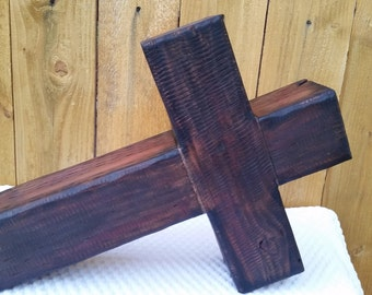 handcrafted cross made from distressed pressure treated 4 x 4 cedar posts dark stain with
