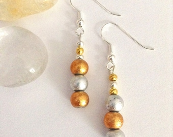 Gold and silver asymmetrical earrings