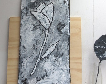 Robust and rustic painting of a tulip in black and white