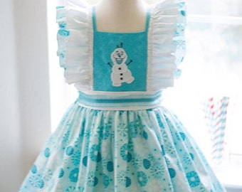 OLAF Dress comes in sizes 12 mos.to 8