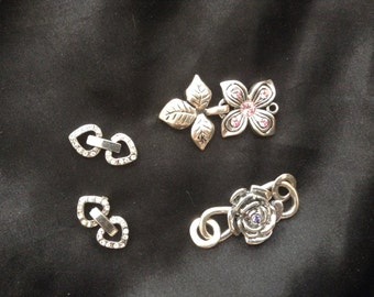 Four Swarovski crystal clasps, flowers and hearts