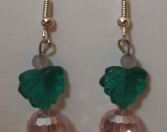 Green leaves and pink beaded dangles, silver tone fish hooks and plastic and glass beads