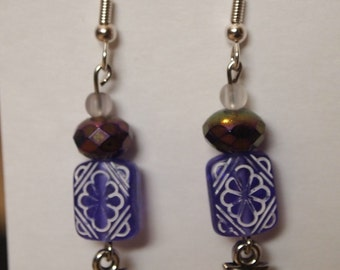Purple beads with shells dangles, silver tone fish hooks and plastic beads