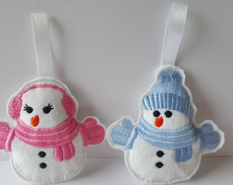 Homemade felt embroidered snowman and snowlady christmas tree decoration made with love within the UK.