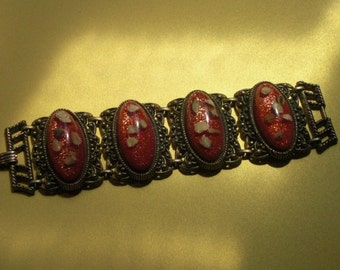 Bracelet (90), 4 medallions red Lucite, to 1950