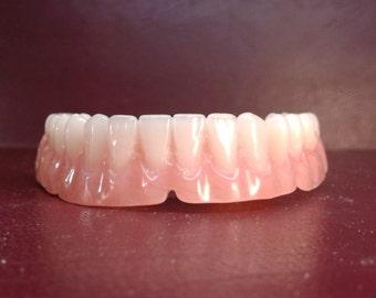 Denture, lower false teeth medium