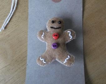 Felt gingerbread man brooch