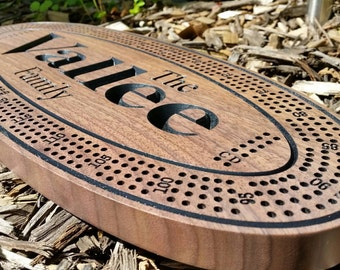 Beautifully crafted, black walnut, Cribbage board. Four run board with 12 metal pegs. Personalized with the names of your choice.