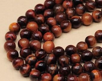 1 Strand of 8 mm round Red Tiger Eye beads   (#J1700)