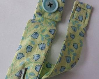Handgel holder - blue flowers on yellow.